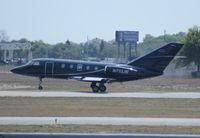 N733JB @ ORL - Falcon 20F