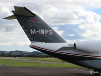 M-IWPS @ EGPN - Close-up of tail unit of M-IWPS (aircraft was parked very close to a fence that prevented a shot of the complete aircraft) parked up at Dundee Riverside. Note a based Cherokee of Tayside Aviation landing in the background. - by Clive Pattle