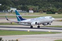 C-GTWS @ TPA - West Jet 737-700 - by Florida Metal