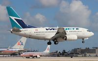 C-GWCY @ MIA - West Jet 737-600 - by Florida Metal