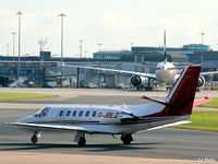 G-JBLZ @ EGCC - Taxy to the Manchester terminal skyline - by Clive Pattle