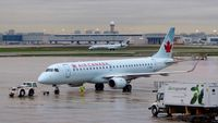 C-FNAN @ CYYZ - Air Canada Embraer 190 on a rainy early morning. - by M.L. Jacobs