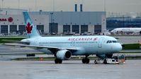 C-FKOJ @ CYYZ - Air Canada Airbus A320 on a rainy early morning. - by M.L. Jacobs