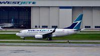 C-FGWJ @ CYYZ - WestJet Boeing 737 on a rainy morning. - by M.L. Jacobs