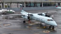 C-GGND @ CYYZ - Air Canada Express Dash 8 on a rainy morning. - by M.L. Jacobs
