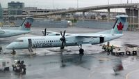 C-GGNZ @ CYYZ - Air Canada Express Dash 8 on a rainy morning. - by M.L. Jacobs