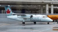 C-GANQ @ CYYZ - Air Canada Express Dash 8 arriving at the terminal. - by M.L. Jacobs
