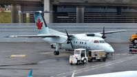 C-GANQ @ CYYZ - Air Canada Express Dash 8 recently arrived at the terminal. - by M.L. Jacobs
