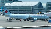 C-FMYV @ CYYZ - Air Canada Embraer 190 at the gate. - by M.L. Jacobs