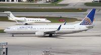 N78438 @ FLL - United 737-900