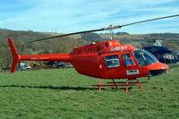 G-BEWY @ EGBC - Bell 206B  Jet Ranger II [348] Cheltenham Racecourse~G 16/03/2004. Wearing red skids.