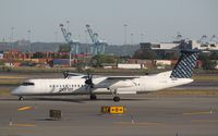 C-GLQO @ KEWR - DHC-8-402Q - by Mark Pasqualino