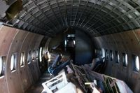 VH-INX @ YMEL - The interior of ex Ansett Airlines of Australia Douglas Dc4 VH-INX at Melton Victoria in mid 1970's - by Peter Lea