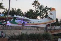 N928J - Singer Jimmy Buffet's HU-16 Albatross in front of his restaurant Margaritaville at Universal City Walk Orlando