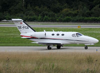 OE-FCB @ LSGG - Taxiing holding point rwy 23 for deparure... - by Shunn311