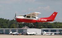 C-GCVM @ KOSH - Cessna T210L - by Mark Pasqualino