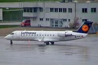 D-ACJC @ EDDM - D-ACRC   Canadair CRJ-100LR [7130] (Lufthansa Regional) Munich-Franz Josef Strauss~D 19/04/2005. Taken during a rain storm.