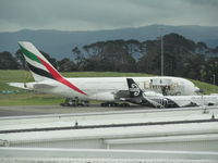 A6-EDO @ NZAA - on apron - taken through glass from observation gallery - by magnaman