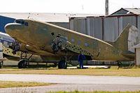 7039 @ FAWB - Douglas DC-3C-47B-25-DK Dakota [15903/32651] (Zimbabwe Air Force) Pretoria-Wonderboom~ZS 19/09/2006. Stored awaiting turbo prop conversion.