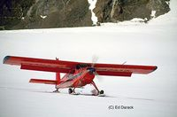 C-GVKG - 1960 Helio H-395 Super Courier. Andy Williams' 1959 Helio model H-395 Super Courier, registration number C-GVKG, landing on the Quintino Sella Glacier on Mount Logan, the highest mountain in Canada, in June, 1993. - by Ed Darack