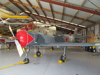 ZK-YAC @ NZTG - in museum hangar - flying condition - by magnaman