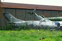 0742 @ LKKB - Mikoyan-Gurevich MiG-19P Farmer [650742] (Czech Air Force) Prague-Kbely~OK. Behind fence in storage compound. - by Ray Barber