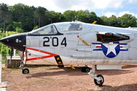 150879 @ N.A. - Front fuselage of F-8E(FN) Crusader at the Chateau de Savigny aircraft museum. Flew with Aeronavale, but shown in US Navy c/s. - by Henk van Capelle