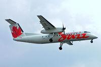 C-GHTA @ CYYZ - De Havilland Canada DHC-8-301 Dash 8 [198] (Air Canada Jazz) Toronto~C 25/06/2005 - by Ray Barber