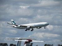B-HXK @ NZAA - landing at NZAA - long shot in heat haze over convair apron - by magnaman