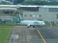 ZK-TLE @ YBBN - Parked at southern end of airfield. - by magnaman