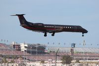 N500DE @ DAB - Dale Earnhardt Inc Embraer in front of the Daytona Speedway