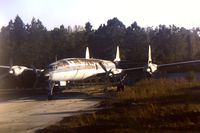 UNKNOWN @ SFB - Derelict Lockheed Constellation (unidentified) possibly used for training ground staff - parked at northern end on main runway SFB - as seen from departing flight.  Scanned from original slide - by Neil Henry