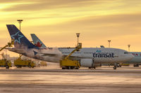 C-GTSH @ CYYZ - Deicing in Toronto at sunrise - by BlindedByTheFlash