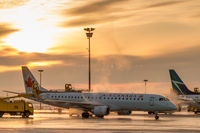 C-FHNP @ CYYZ - Deicing in Toronto at sunrise - by BlindedByTheFlash