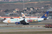 CS-TRH @ LEMD - With Evelop titles; taxying to depart Madrid. - by alanh