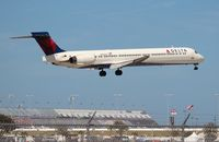 N944DN @ DAB - Delta MD-90 in front of the Daytona 500