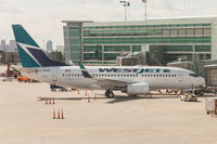 C-GGWJ @ CYYZ - Parked at Terminal 3 at Toronto Pearson - by BlindedByTheFlash