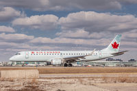 C-FHIQ @ CYYZ - Taxiing at Toronto Pearson - by Robert Jones