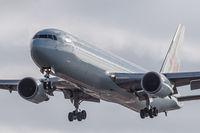 C-GHOZ @ CYYZ - Landing 05 at Toronto Pearson - by Robert Jones