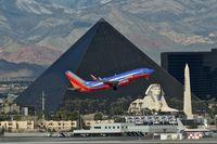 N201LV @ KLAS - Southwest Airlines, is here departing Las Vegas Int'l(KLAS), in front of the famous Luxor Hotel - by A. Gendorf