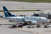 C-GTWS @ KFLL - Boeing 737-700 - by Mark Pasqualino
