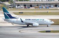 C-GWBT @ KFLL - Boeing 737-700 - by Mark Pasqualino