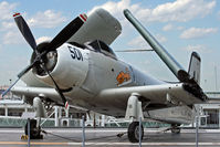 09102 - In 2014, this rare aircraft, a prototype and the oldest Skyraider, was brought to the U.S.S. Intrepid Air Sea Space Museum from the NAS Oceana Aviation Heritage Park. - by Daniel L. Berek