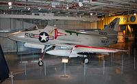 142833 - Cold-War fighter on the hangar deck. - by Daniel L. Berek