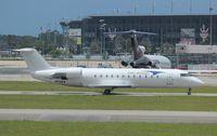 N93EA @ DAB - Elite Airways CRJ-200