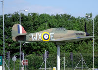 BAPC267 @ EGSU - Another view of the gate guard, a plastic Hurricane, at the IWM Duxford - by Clive Pattle