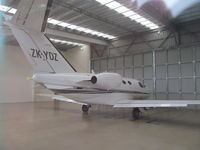 ZK-YDZ @ NZAR - Hiding in owner's hangar at Ardmore - ex VH-YDZ so no expense spared on painting new registration!! - by magnaman