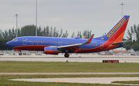 N233LV @ PBI - Southwest 737-700 - by Florida Metal