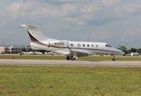 N310QS @ ORL - Net Jets Phenom 300