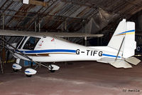 G-TIFG @ EGCB - Tucked away in a hangar at Barton, EGCB - by Clive Pattle